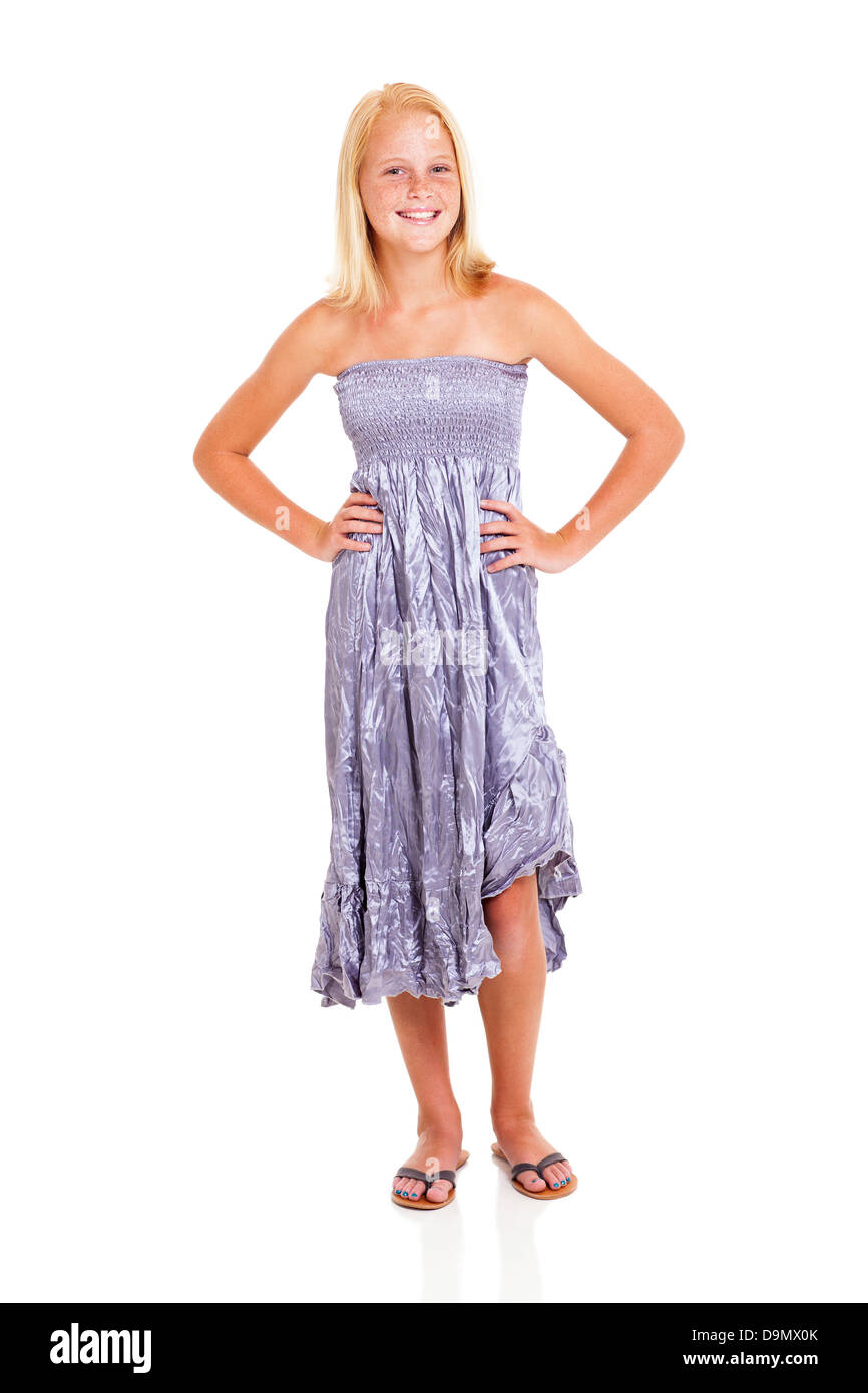 happy pre teen girl in silver dress isolated on white - Stock Image