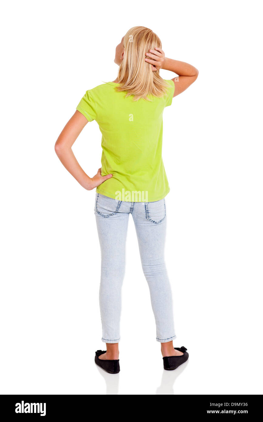 rear view of pre teen girl thinking - Stock Image