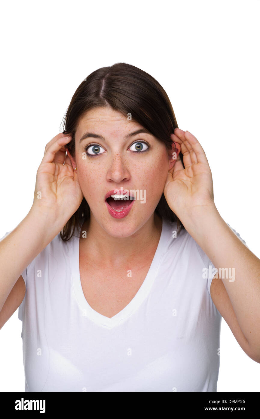 Woman listens in with both ears  (Model release) - Stock Image
