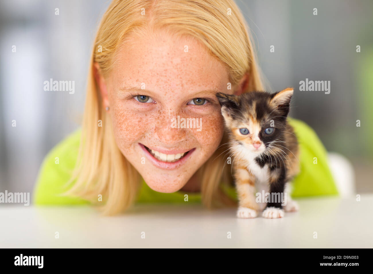 beautiful teen girl with her little kitten pet - Stock Image