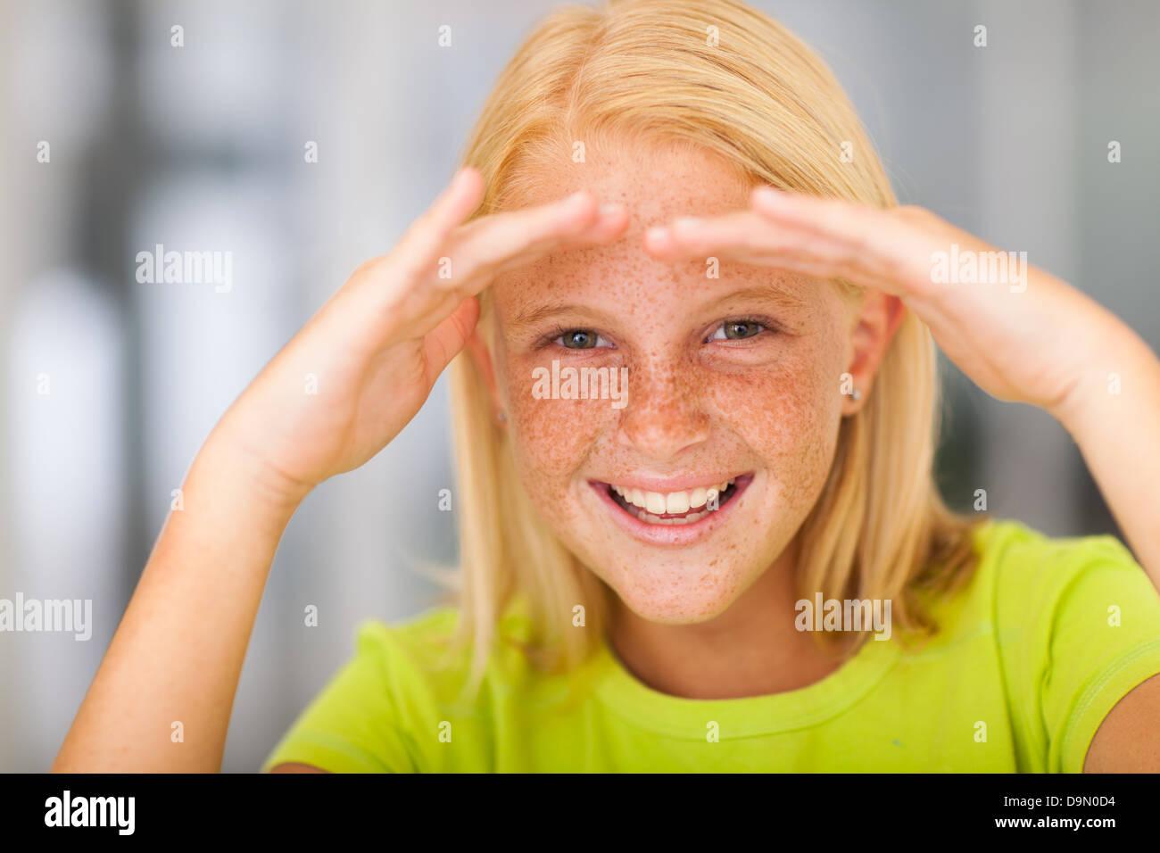 happy pre teen girl looking forward Stock Photo