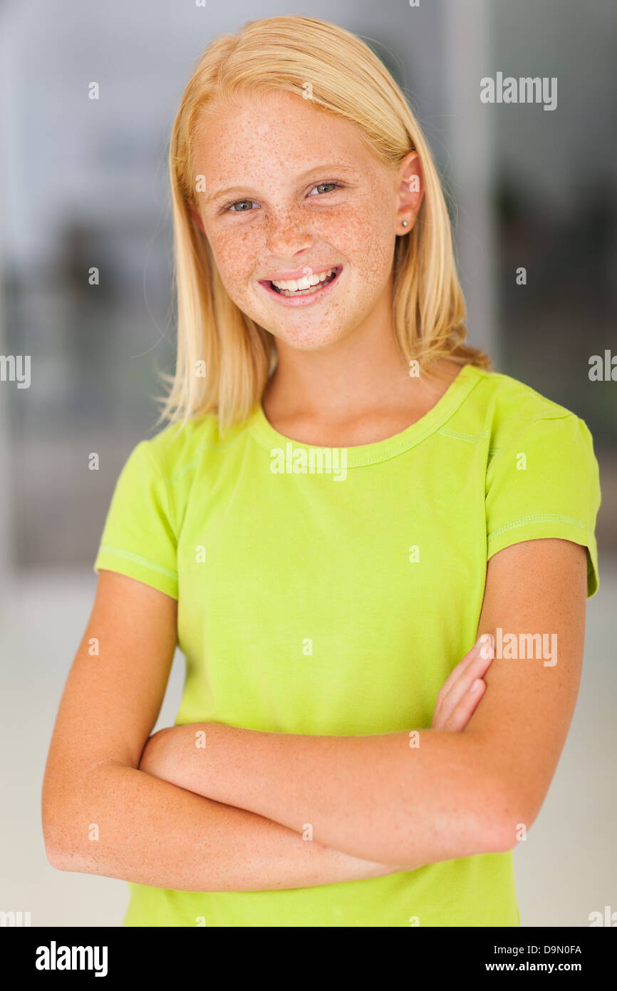 confident preteen girl portrait with arms crossed - Stock Image