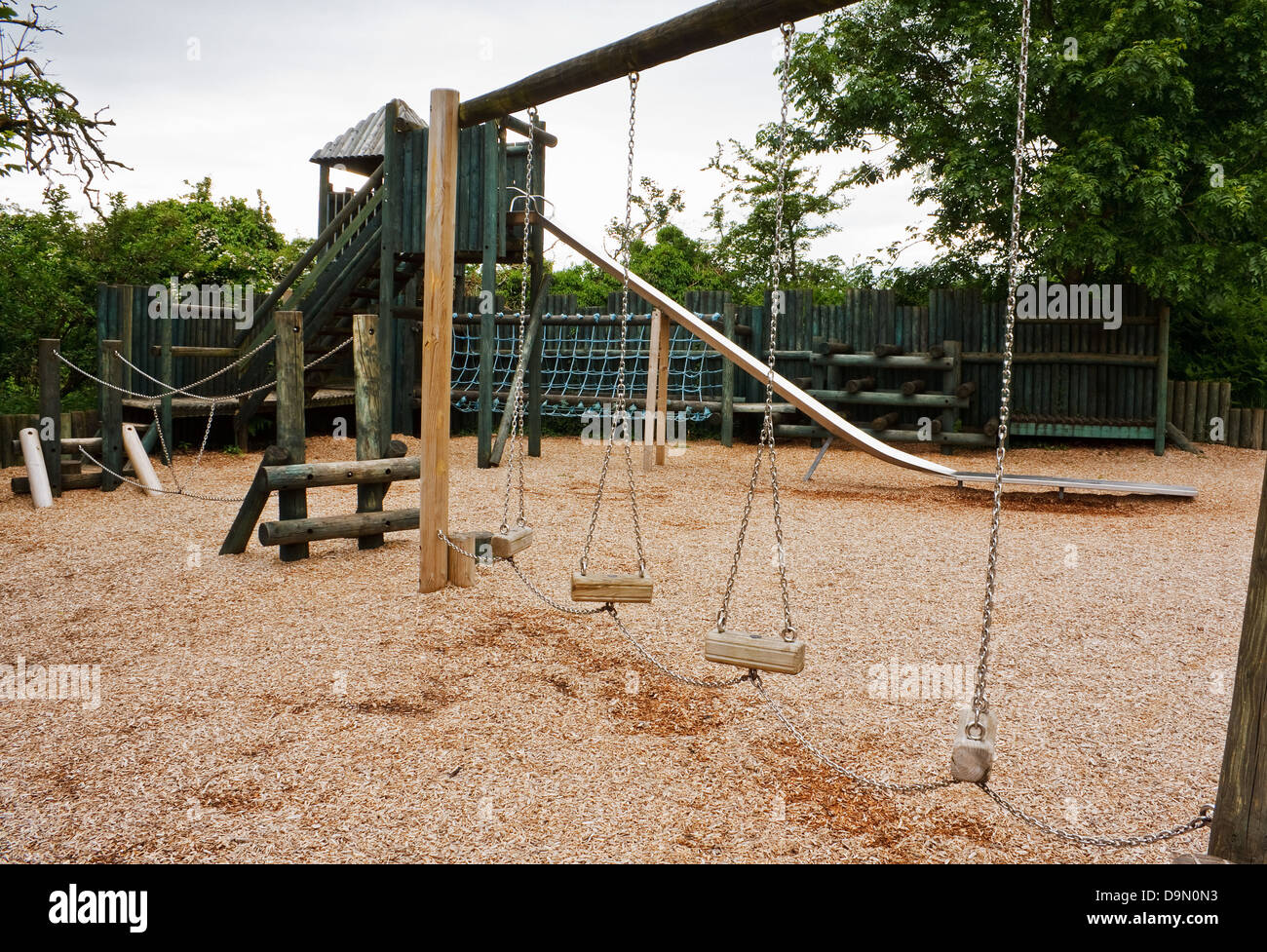 Adventure Playground for young children to enjoy with a slide, rope tunnel and castle turrets - Stock Image