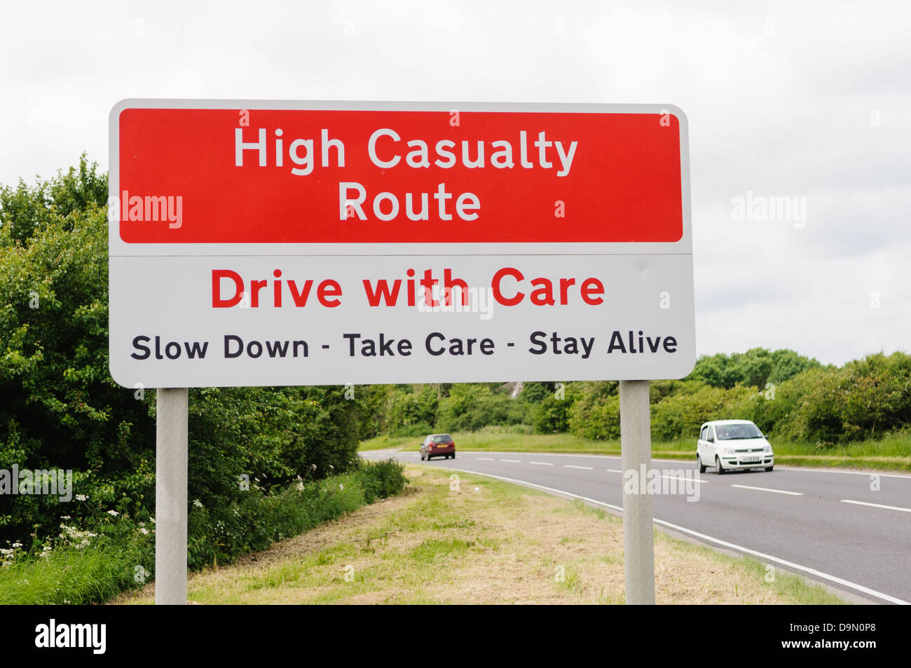 Sign warning drivers they are in a high casualty area and to drive with care and slow down - Stock Image