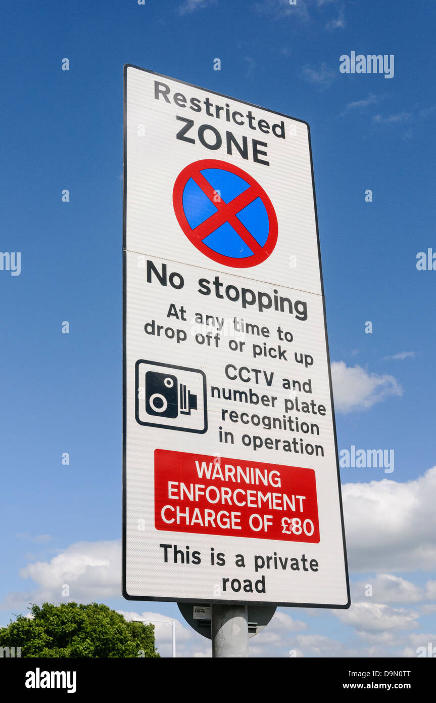 Warning sign to motorists that they are entering a restricted zone at an airport that stopping is not permitted. - Stock Image