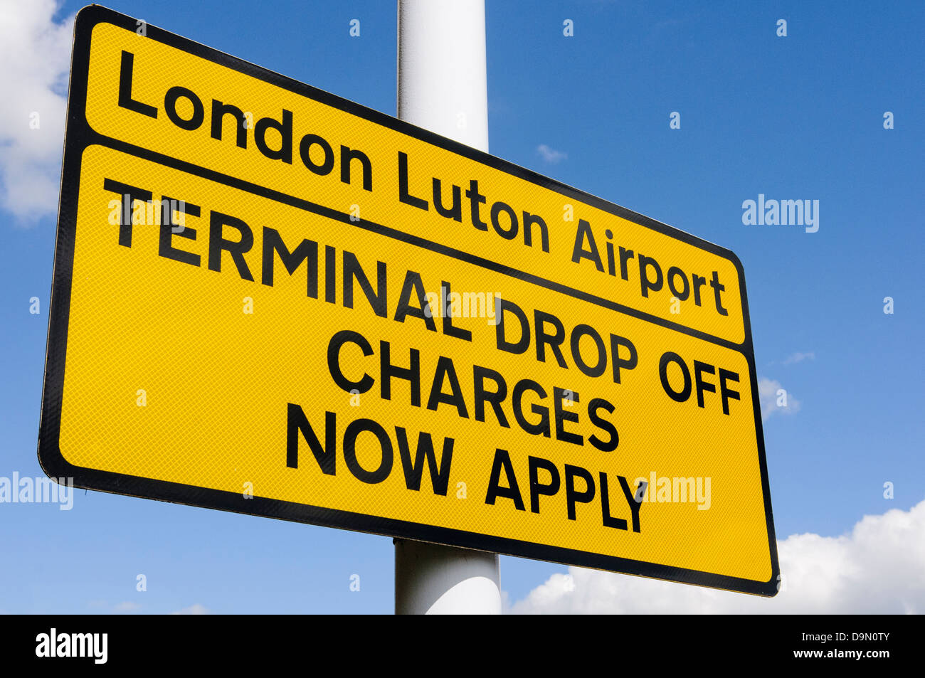 Sign at entrance to Luton Airport warning motorists that terminal drop off charges now apply Stock Photo
