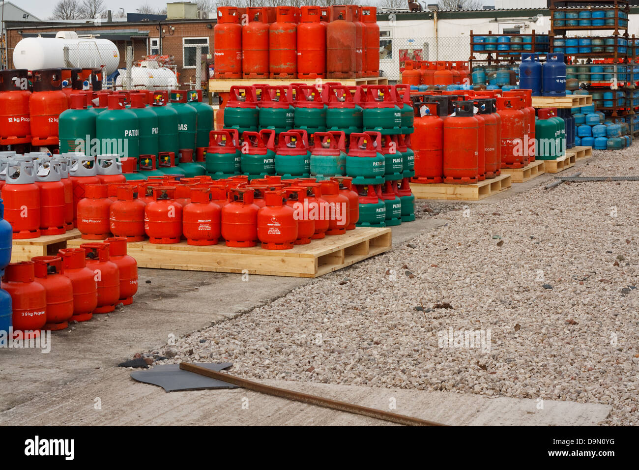 Domestic propane gas bottles in storage at a distribution centre - Stock Image