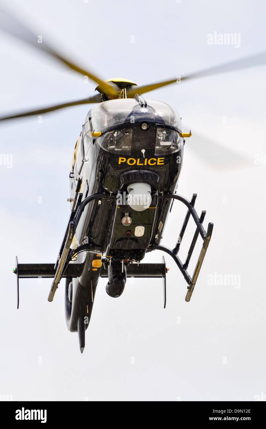 PSNI police helicopter Eurocopter EC-135 G-PSNI in flight - Stock Image