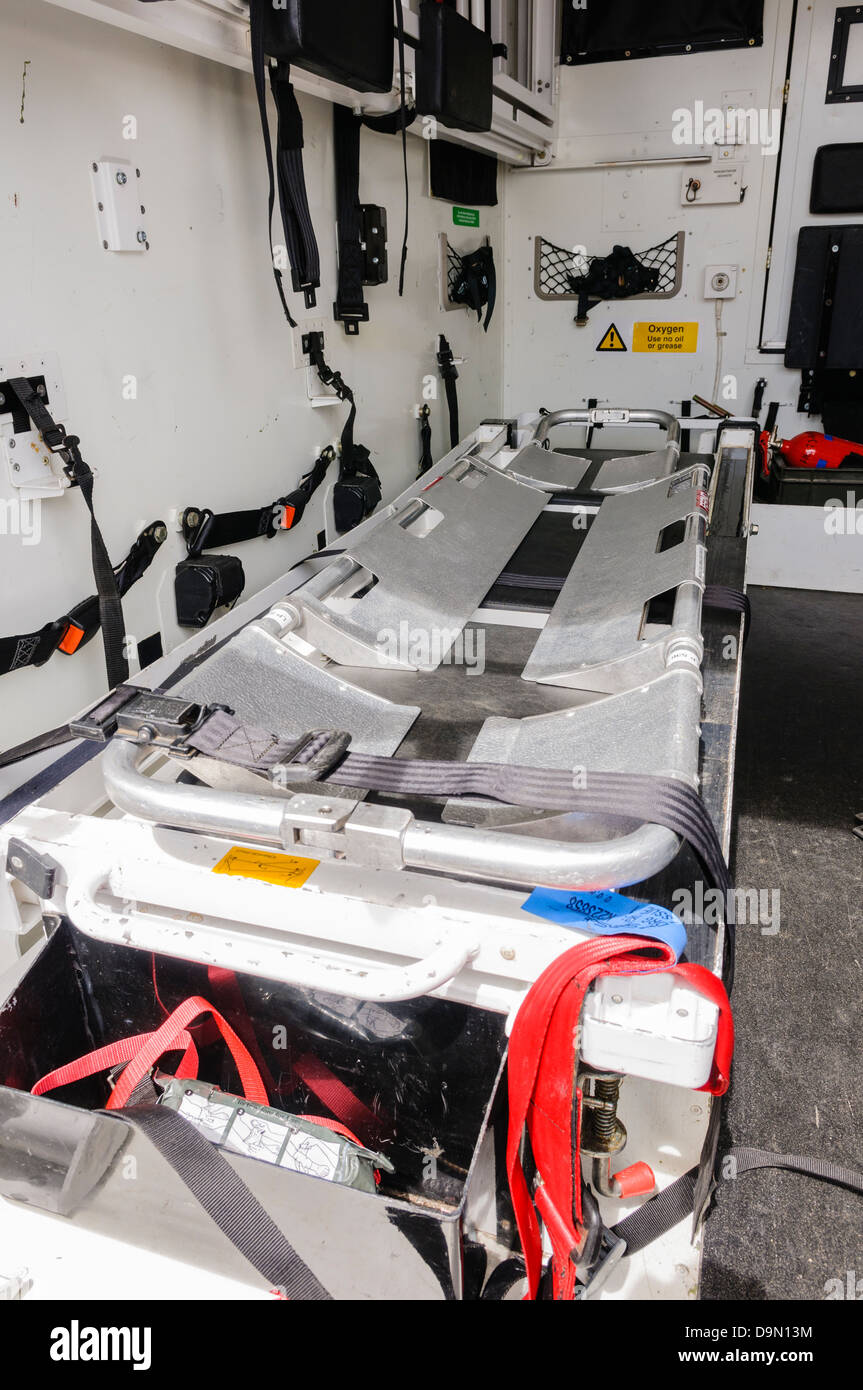 Stretcher inside a military ambulance and extraction vehicle. - Stock Image