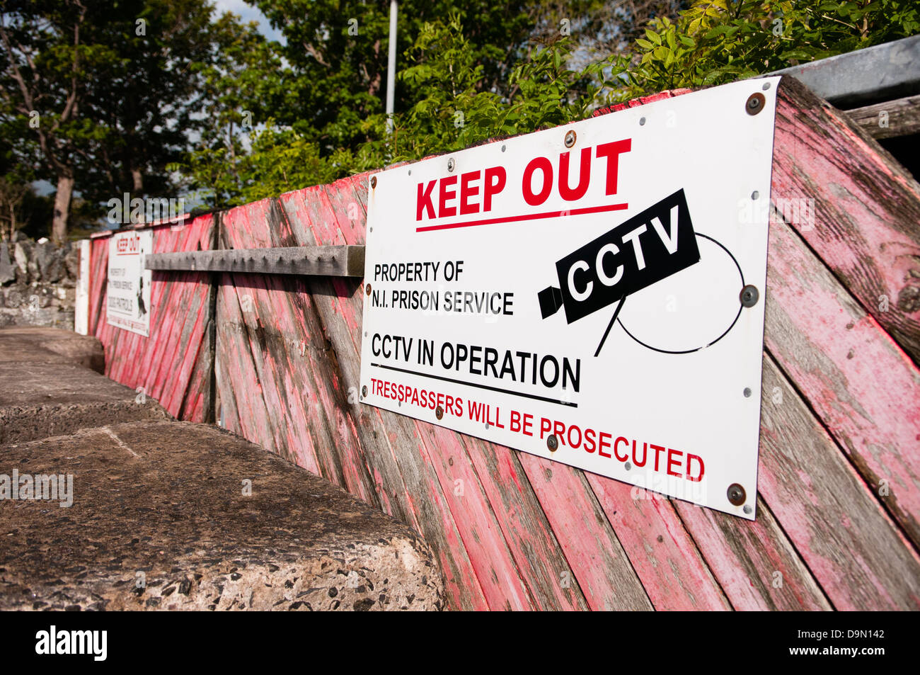 Sign at the entrance to a Northern Ireland Prison Service property, warning trespassers to keep out - Stock Image