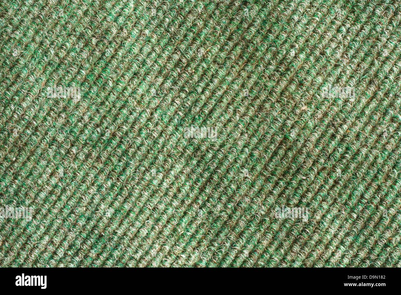 green hard wearing twist carpet texture often found on office floors - Stock Image