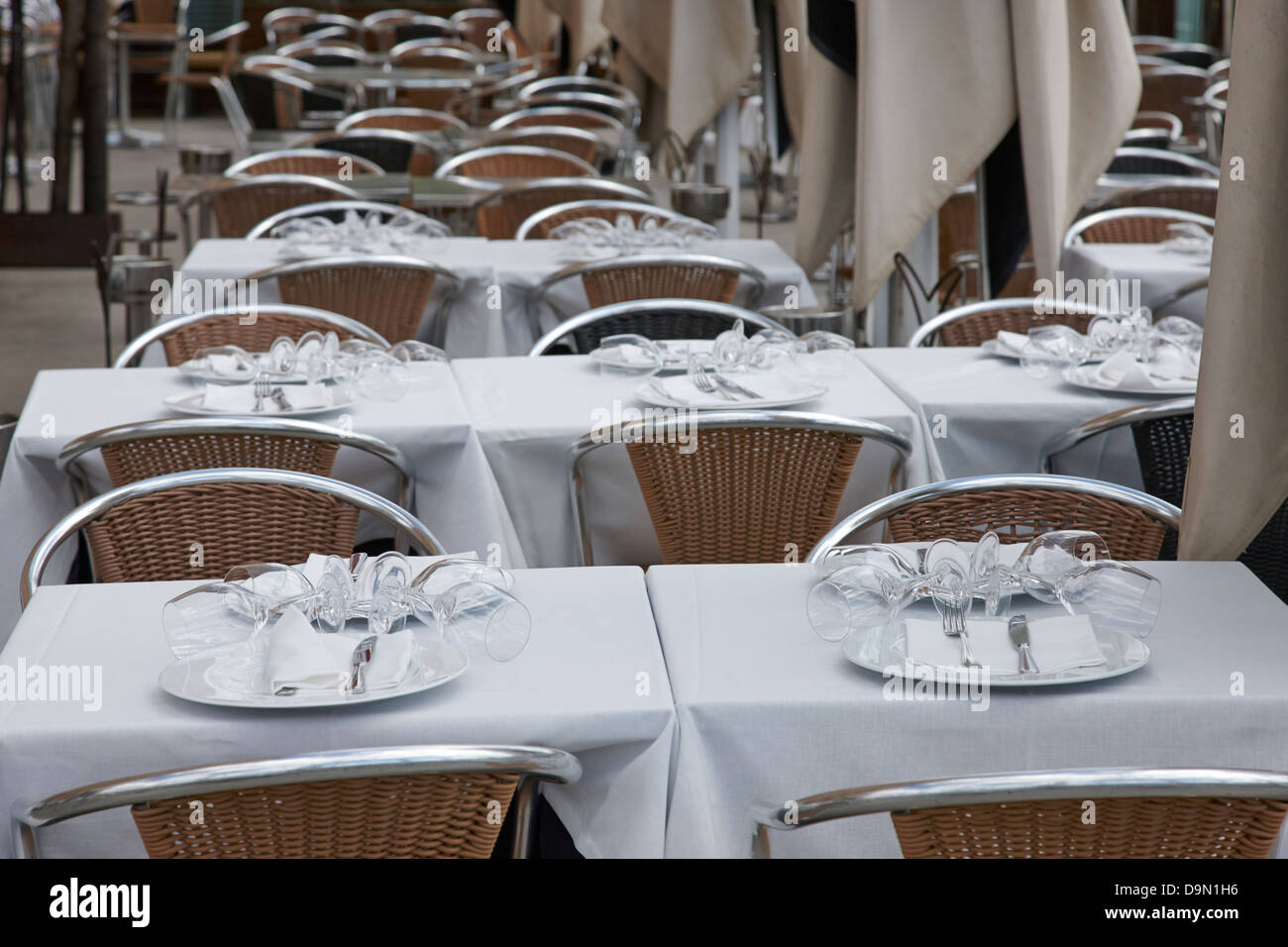 place settings on a table in an empty restaurant barcelona catalonia spain - Stock Image