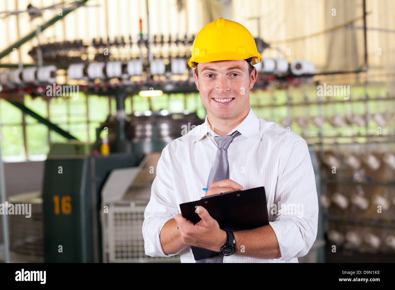 textile factory manager portrait in production area - Stock Image