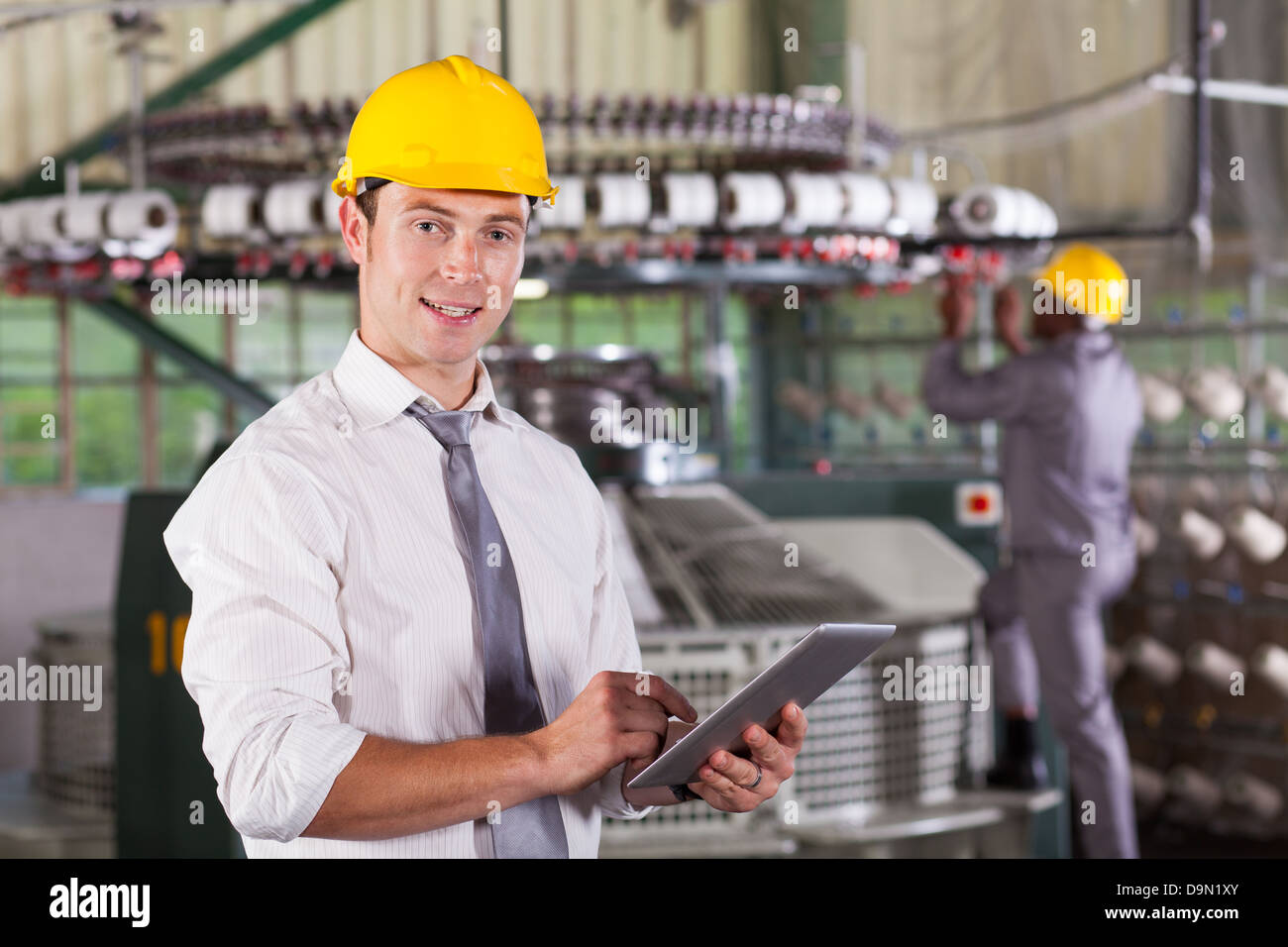 modern textile factory manager using tablet computer - Stock Image