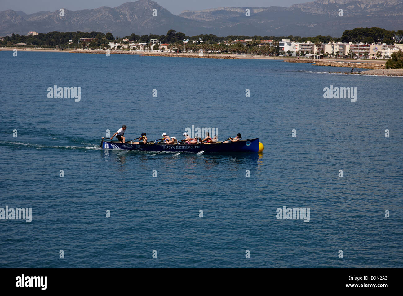 womens rowing team practising rounding buoy at Cambrils Catalonia Spain - Stock Image