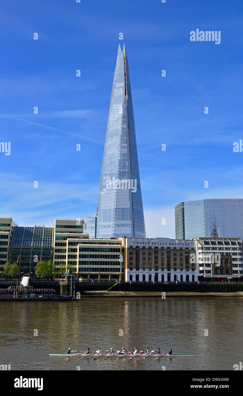 Coxed eight rowing on the River Thames past The Shard, London Bridge Quarter, London, United Kingdom - Stock Image