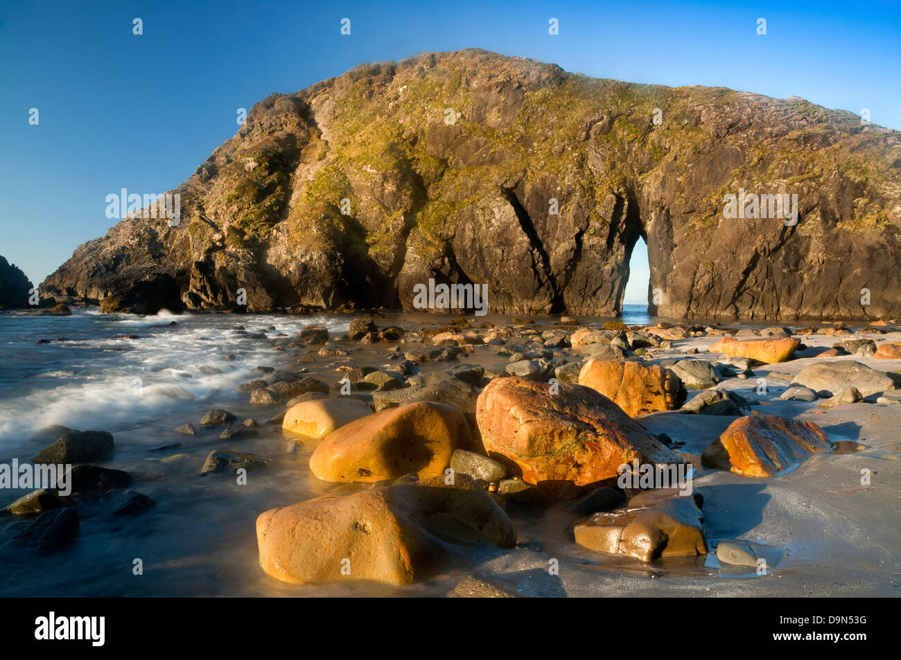 OR01082-00...OREGON - Colorful boulders on Rock Beach in Harris Beach State Recreation Area. - Stock Image