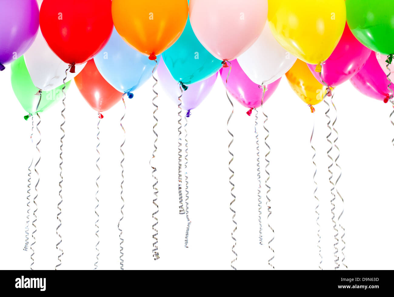 color balloons with streamers on birthday party - Stock Image