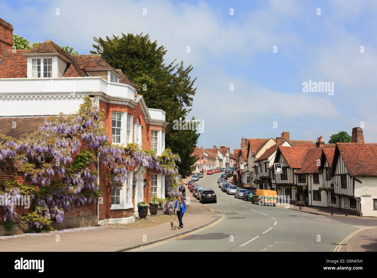 View along the main street in picturesque historic medieval village centre. Lavenham, Suffolk, England, UK, Britain - Stock Image