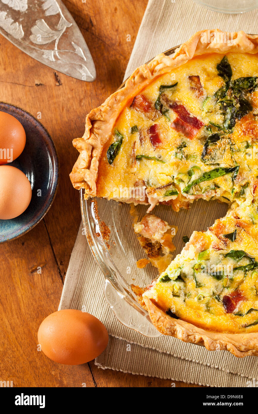 Homemade Spinach and Bacon Egg Quiche in a pie crust - Stock Image