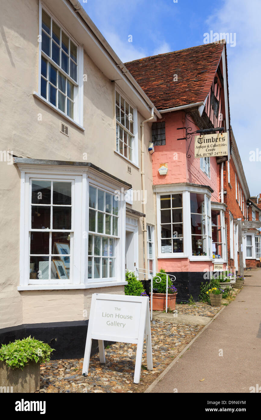 Lion House Gallery and small shops in popular historic village High Street, Lavenham, Suffolk, England, UK, Britain - Stock Image