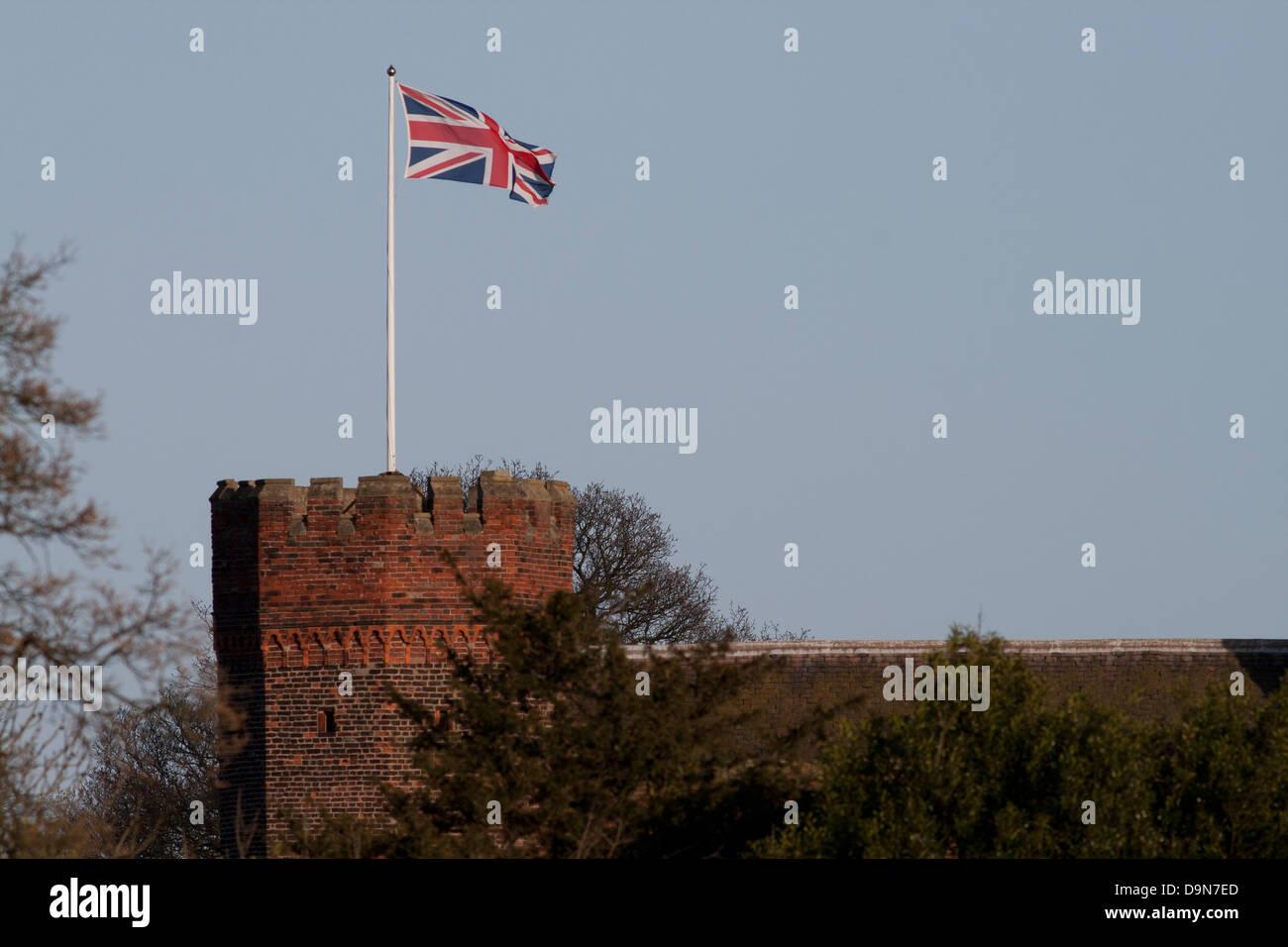 Union Jack on flagpole on top of tower - Stock Image