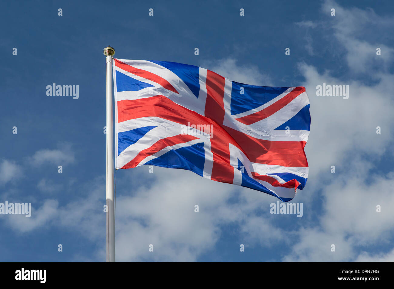 Union Jack Flag on Flagpole Blowing in Wind - Stock Image