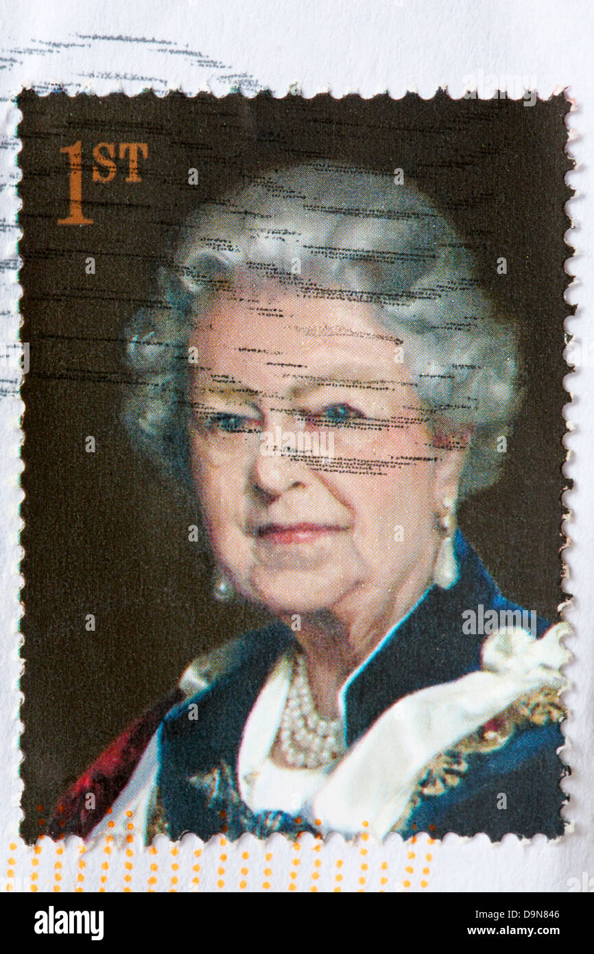 1st class stamp showing Queen Elizabeth II stuck on white envelope - Stock Image