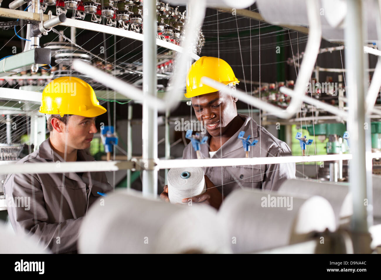 two textile workers at work - Stock Image