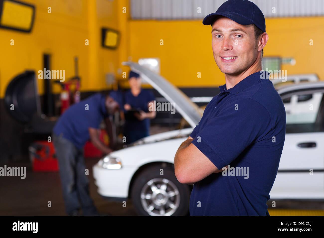 auto service business owner portrait inside workshop - Stock Image