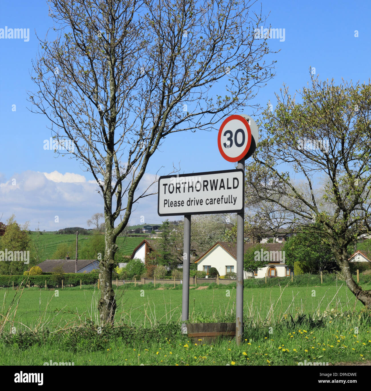30 MPH Traffic Road Sign at Torthorwald Village, Dumfries and Galloway, Scotland, UK - Stock Image