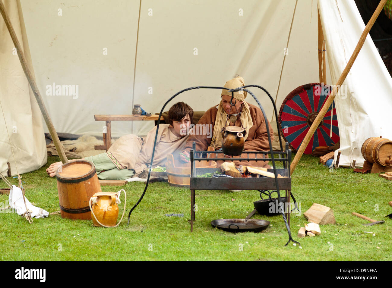 Reenactment of life in a Viking village, people cooking food, Peterborough Heritage Festival 22 June 2013, England - Stock Image