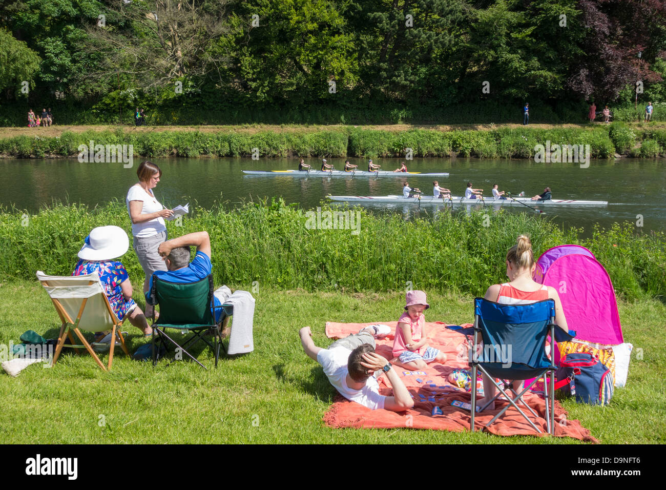 People on the riverside at Durham during Durham rowing regatta. Durham, England, UK - Stock Image