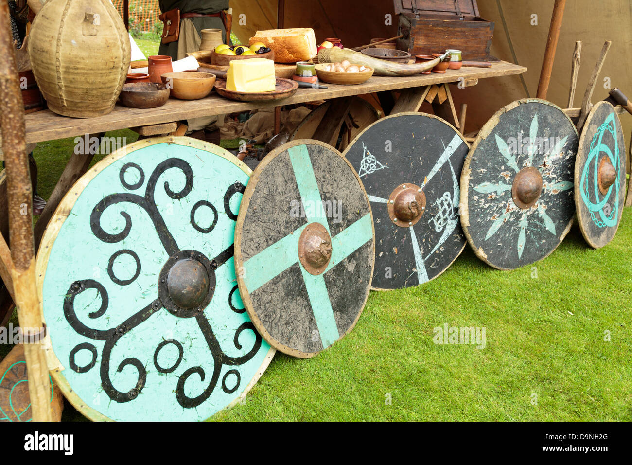Reenactment of life in a Viking village, row of shields, Peterborough Heritage Festival 22 June 2013, England - Stock Image