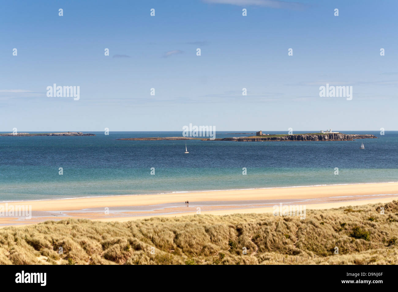View of Farne Islands from the beach and coastline of Northumberland. Took on a lovely sunny day,  shows yachts Stock Photo