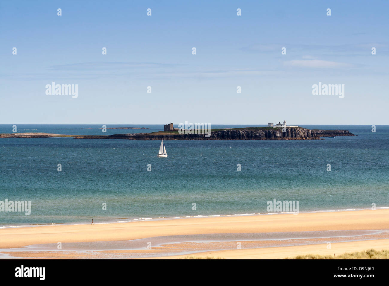 View of Farne Islands from the beach and coastline of Northumberland. Took on a lovely sunny day,  shows a yacht Stock Photo