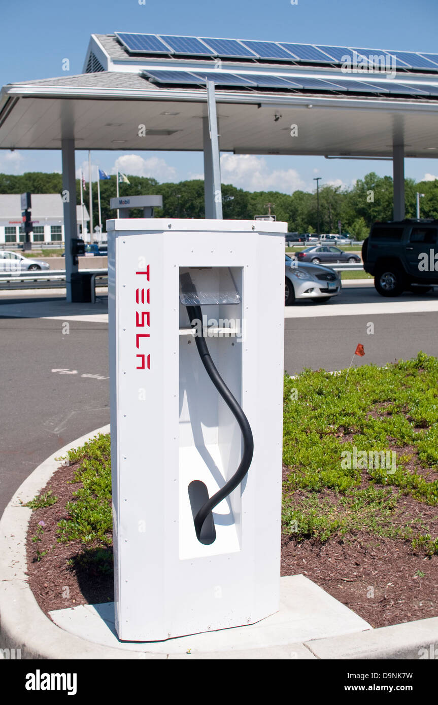 Tesla Motors charging station (supercharger) at a rest area in Milford, Connecticut, USA. The fastest chargers for - Stock Image