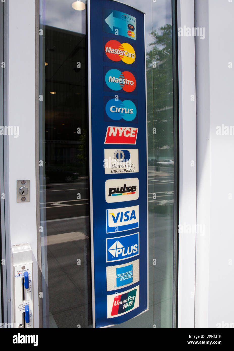 Multiple credit card brand label affixed to store entrance - Stock Image