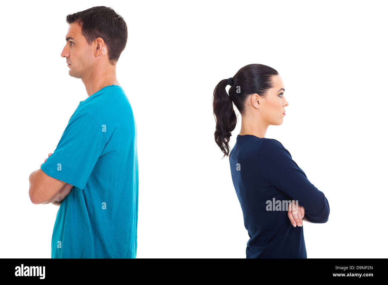 young couple having argument and turning their back on each other - Stock Image