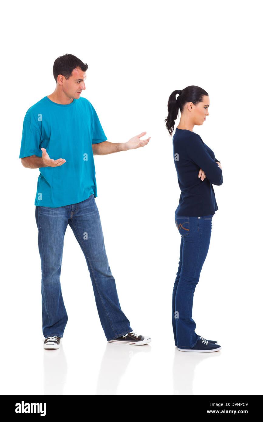 unhappy couple having argument isolated on white background - Stock Image