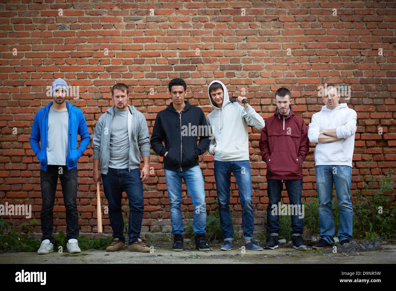 Portrait of several street hooligans or rappers - Stock Image