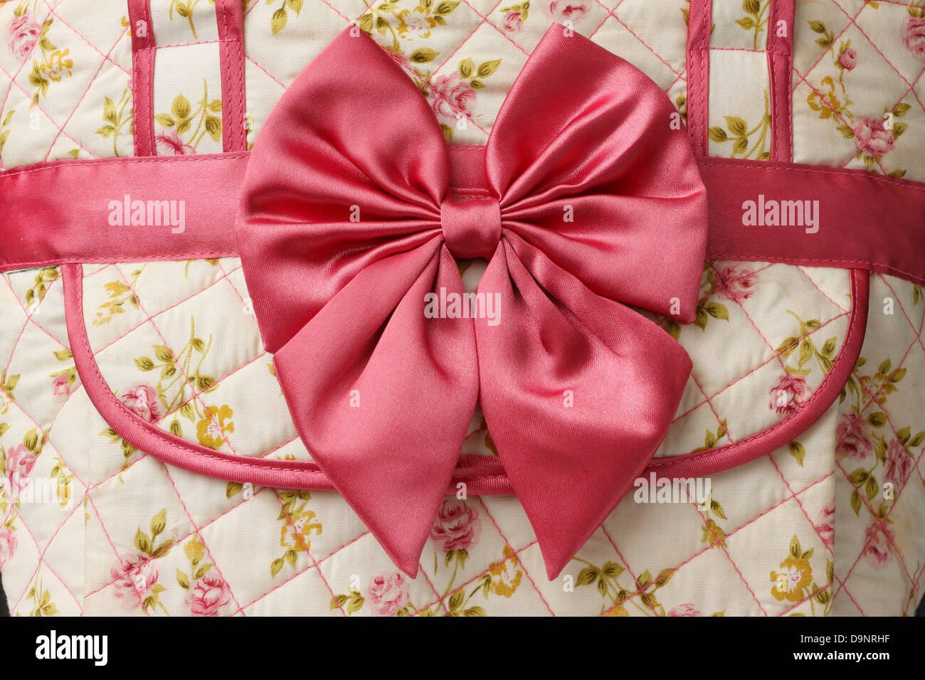 red bow handmade with fabric flower texture - Stock Image