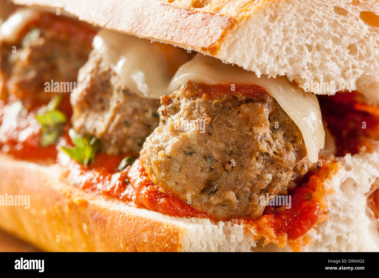 Homemade Spicy Meatball Sub Sandwich with Marinara Sauce and Cheese - Stock Image