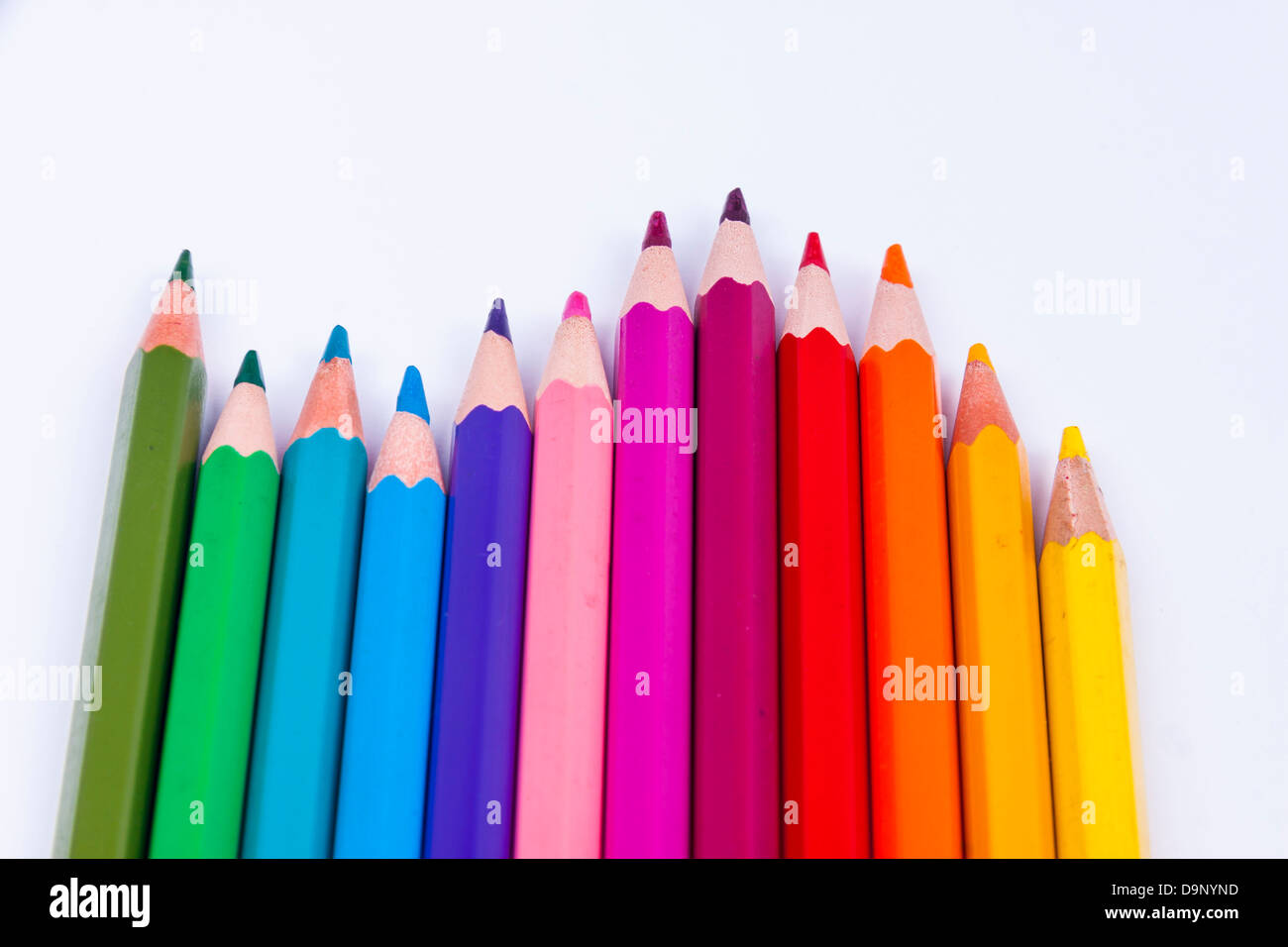 Pallet of colourful crayons on white background. - Stock Image