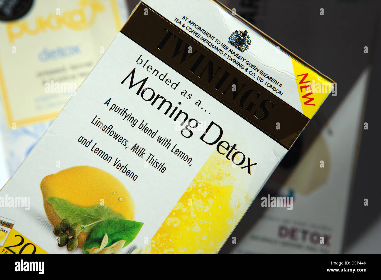 Box of Twinings Morning Detox herbal tea bags with other makes of Detox teas behind - Stock Image
