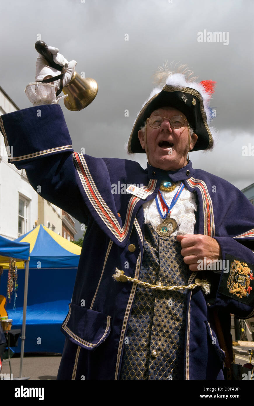Alton Town Crier at work in High Street, Alton during the town's Regency Day and bicentenary celebrations - Stock Image