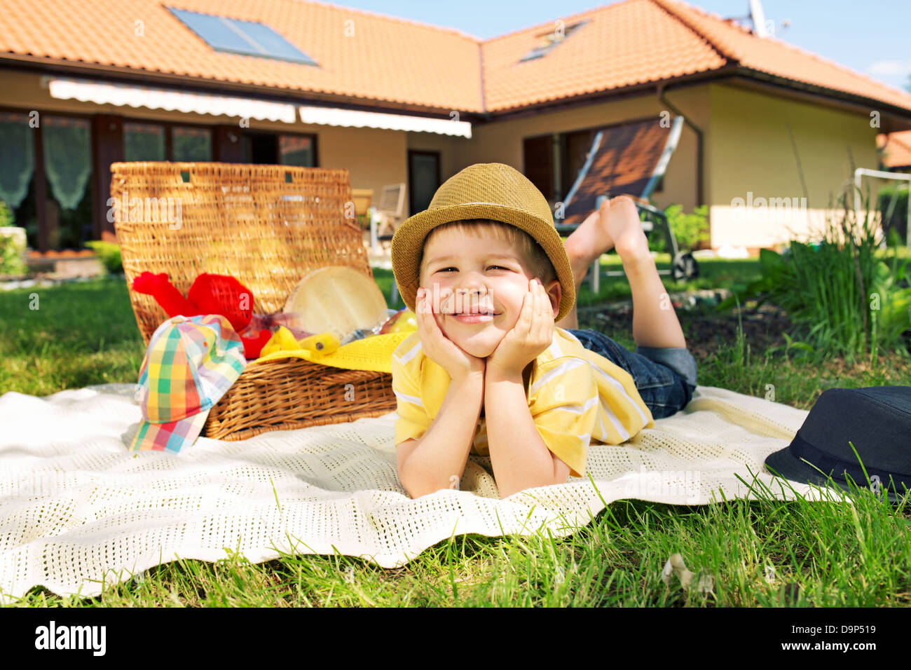 Glad little kid in the garden - Stock Image
