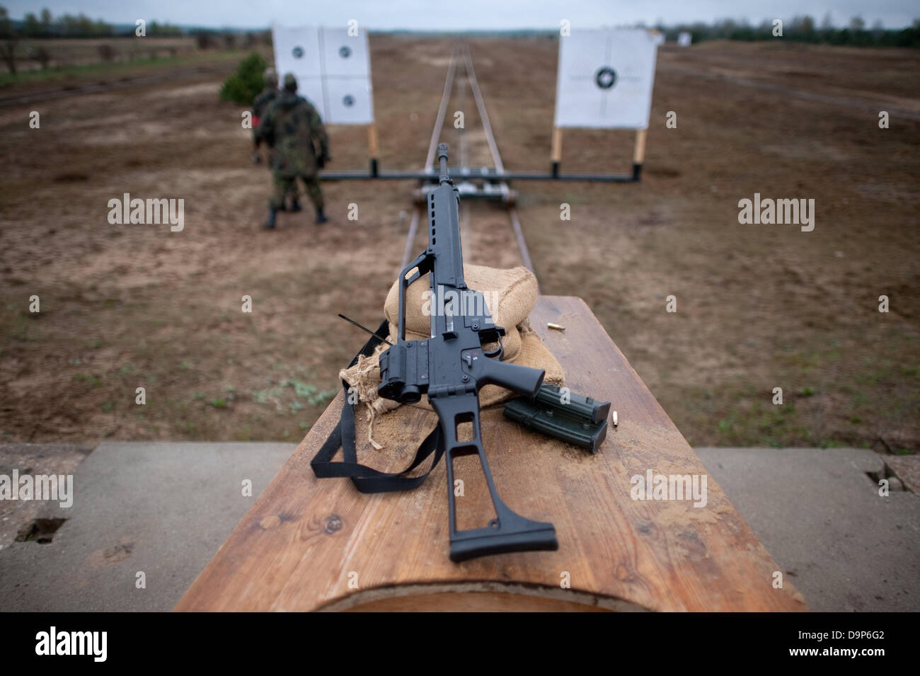 Members of an reservist company of teh German Armed Forces exercise on a shooting range with their assault rifle Stock Photo