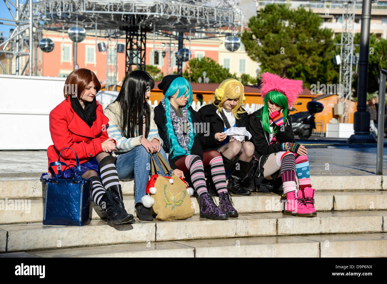 Young girls dressed up as punk rockers with multi colored wigs in Nice France - Stock Image