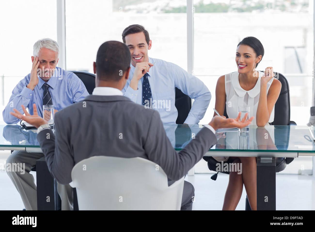 Man gesturing during an job interview - Stock Image